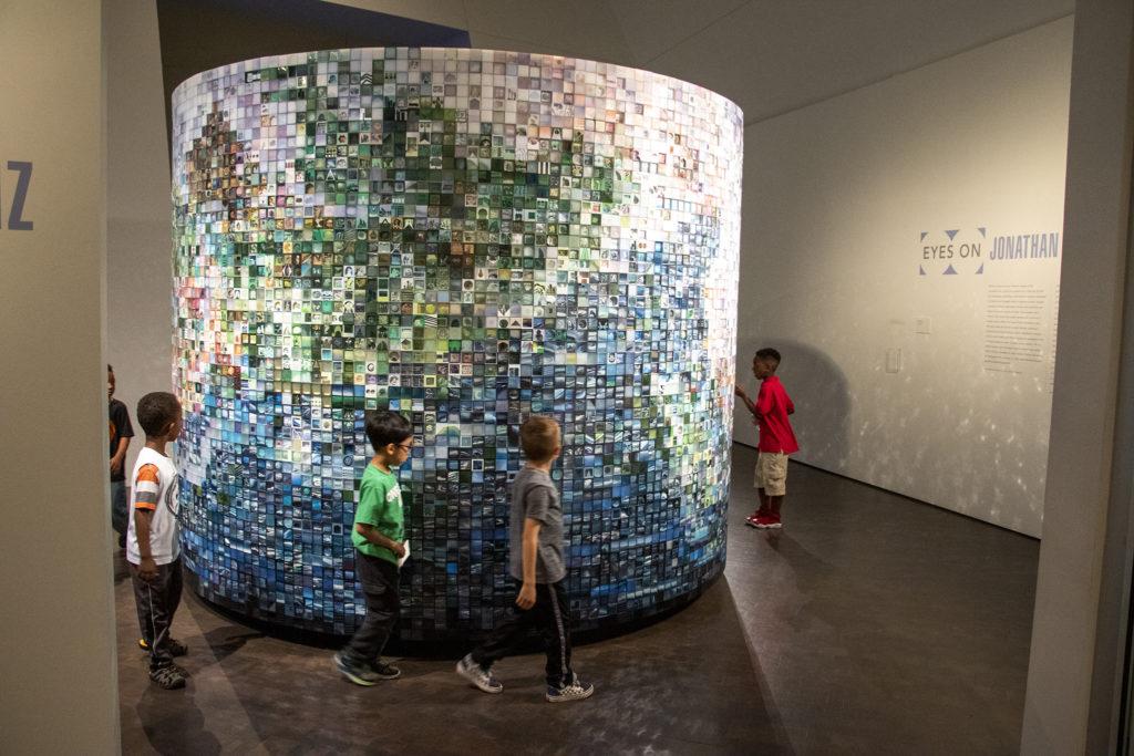 "Kids run around ""Study for Utopia"" by Jonathan Saiz inside the Denver Art Museum, May 15, 2019. (Kevin J. Beaty/Denverite)"