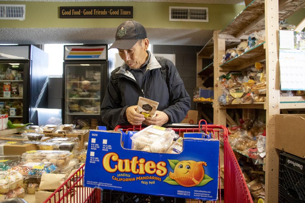 Jianfa Zhang shops at Inner City Parish's food pantry. La Alma-Lincoln Park, May 15, 2019. (Kevin J. Beaty/Denverite)