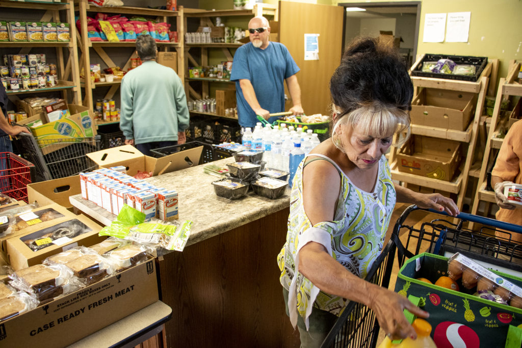 Jeanette Spinks shops at Inner City Parish's food pantry. La Alma-Lincoln Park, May 15, 2019. (Kevin J. Beaty/Denverite)