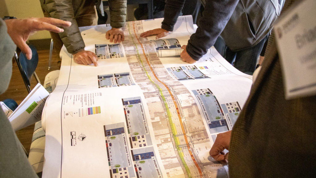 """Denver Public Works holds open """"office hours"""" about the Broadway bikeway's future. Metropolis Coffee, May 22, 2019. (Kevin J. Beaty/Denverite)"""