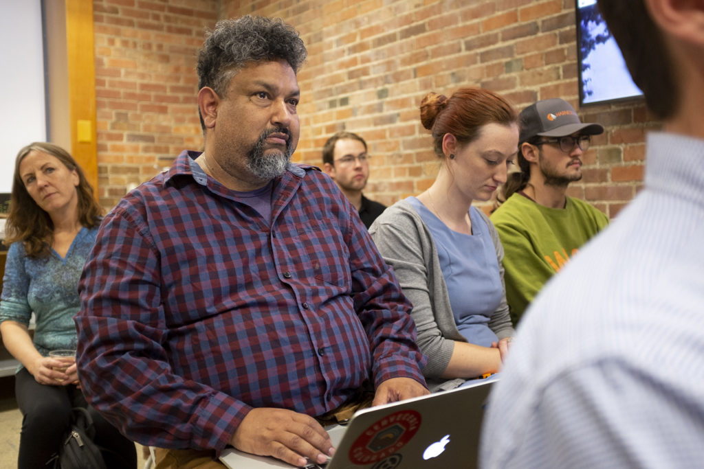 Eddie Soto watches during a launch event for a ballot measure that would create a carbon tax in Denver, May 23, 2019. (Kevin J. Beaty/Denverite)
