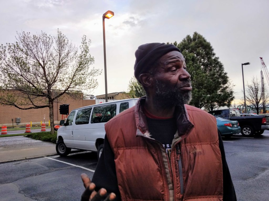 Jerry Burton, a Denver Homeless Out Loud activist who has lived on and off the streets, reacts May 7, 2019 to news Denver voters had rejected a bid to overturn the city's urban camping ban. (Donna Bryson/Denverite)