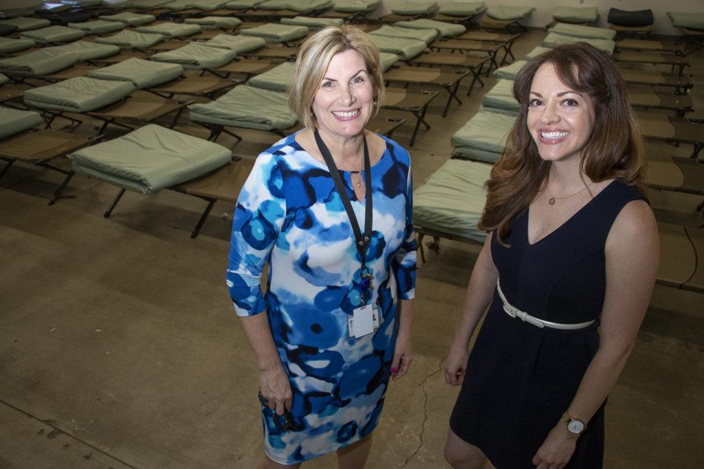 Catholic Charities' Cheryl Talley (left) and Nissa LaPoint pose for a portrait inside the Samaritan House short-term women's shelter, June 7, 2019. (Kevin J. Beaty/Denverite)
