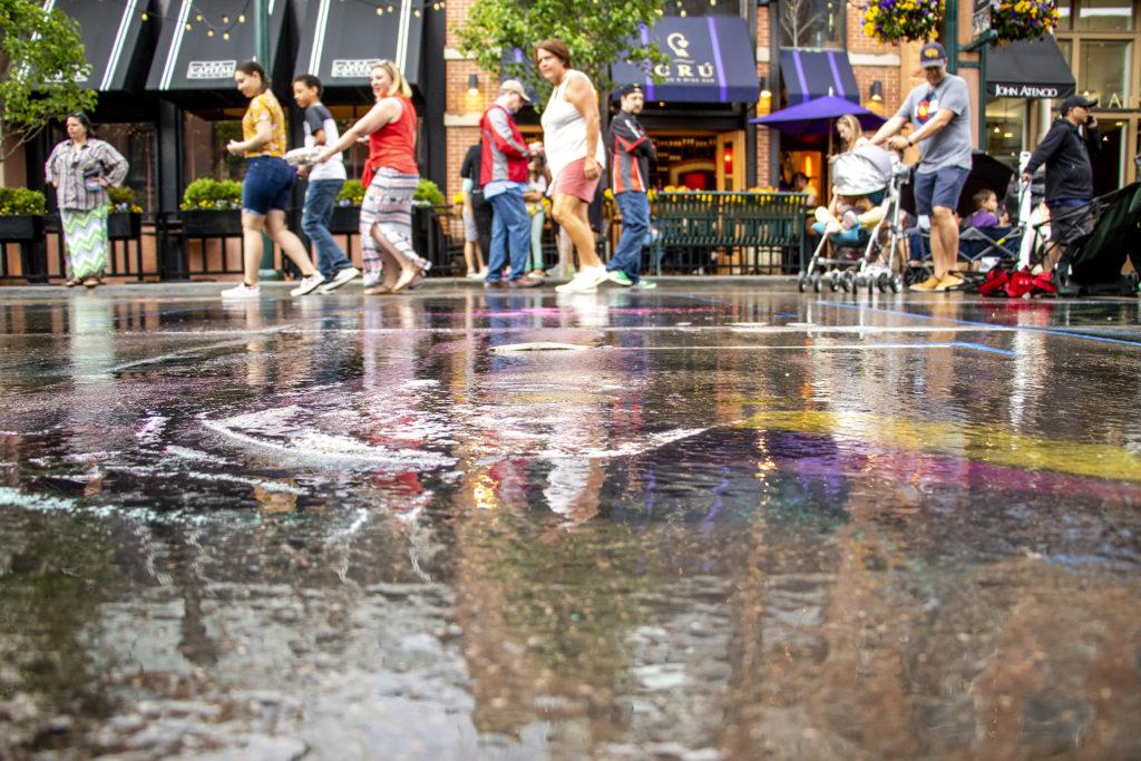 It rained over the Denver Chalk Art Festival at Larimer Square, June 1, 2019. (Kevin J. Beaty/Denverite)