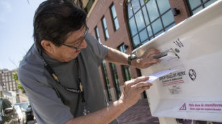 Kenny Borrego casts his ballot outside of the Blair-Caldwell African American Research Library on Welton Street. Five Points, June 4, 2019. (Kevin J. Beaty/Denverite)