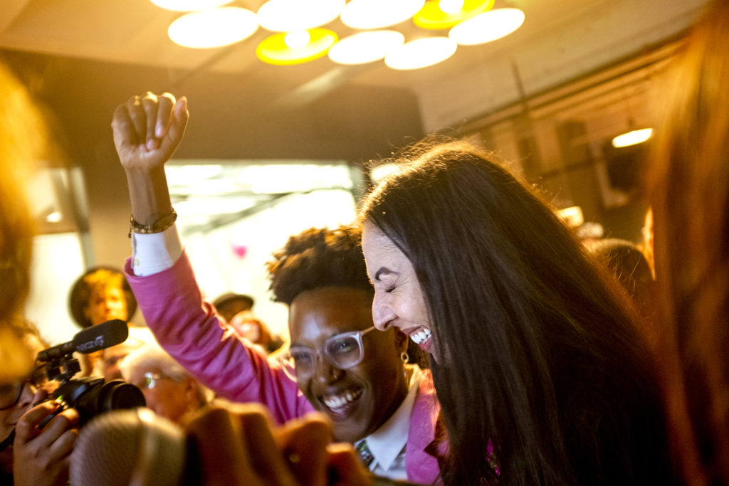 Candi CdeBaca (right) celebrates as election results come in showing her lead over incumbant Albus Brooks, June 4, 2019. (Kevin J. Beaty/Denverite)