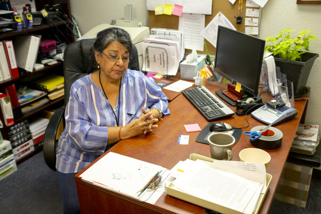 Cynthia Dekker speaks to a reporter at her desk inside Giving Heart Englewood, June 6, 2019. (Kevin J. Beaty/Denverite)