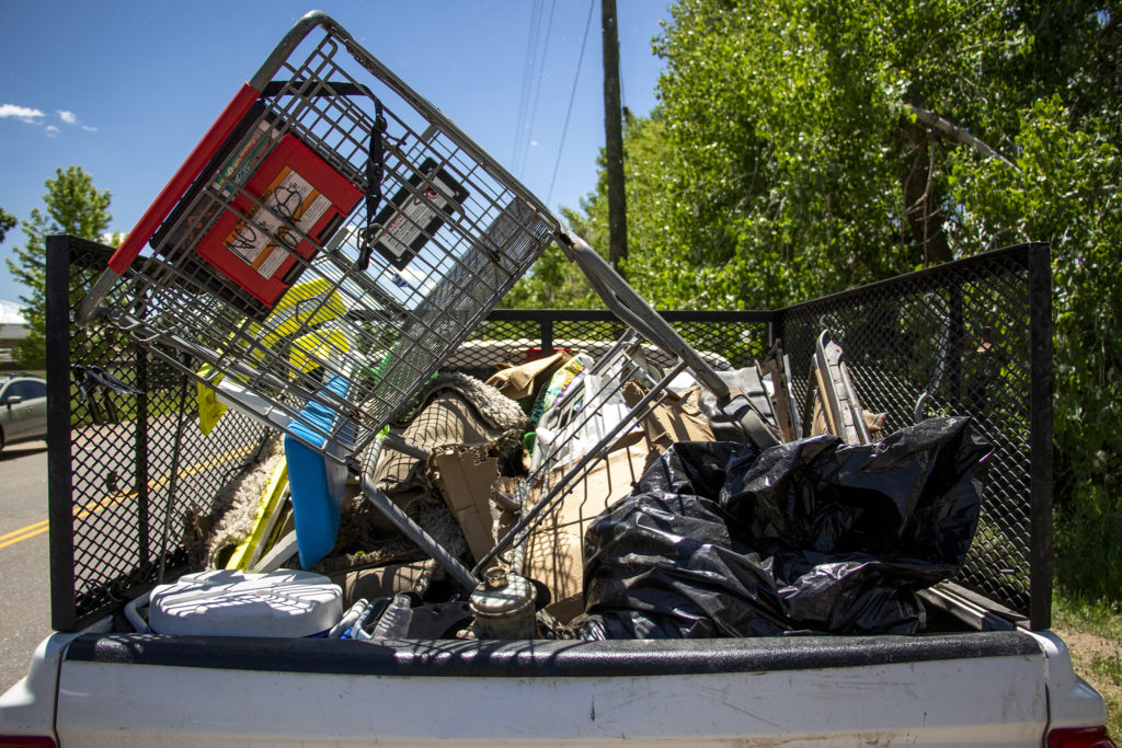 Items from an encampment in Englewood bound for a landfill, June 6, 2019. (Kevin J. Beaty/Denverite)