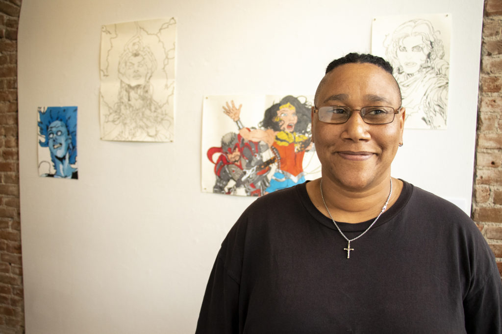Robin Hill poses for a portrait with her work. Art Restart at the Leon Gallery, June 14, 2019. (Kevin J. Beaty/Denverite)