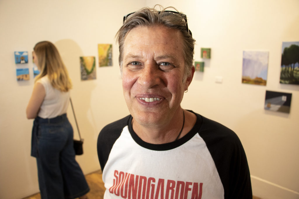 Steve Hartbauer, arts program manager with The Giving Place, poses for a portrait. Art Restart at the Leon Gallery, June 14, 2019. (Kevin J. Beaty/Denverite)