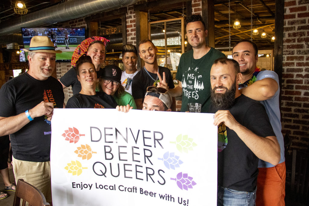 Some of the Denver Beer Queers, with co-founder Michael Pare holding the sign on the right, pose for a picture. Call to Arms Brewing and other craft breweries hold their own PrideFest on Tennyson Street, June 15, 2019. (Kevin J. Beaty/Denverite)