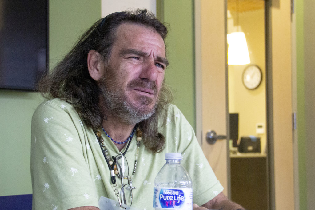 Damon O'Sickey sits in on a group session for patients learning more about Suboxone. Monday, June 17, 2019, at Stout Street Health Center in Denver. (Esteban L. Hernandez/Denverite)