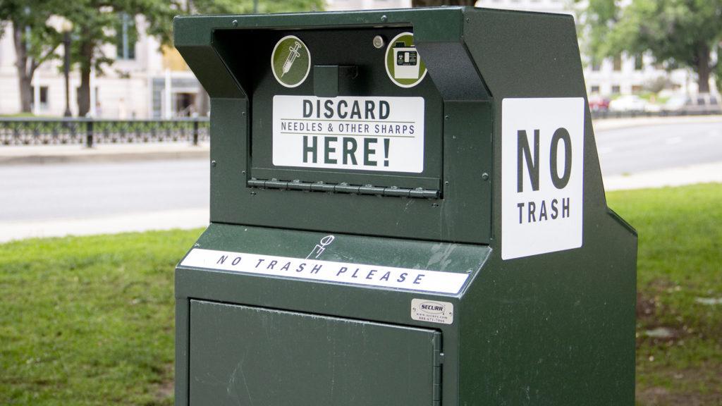 A needle disposal box near Civic Center Park, June 17, 2019. (Esteban L. Hernandez/Denverite)