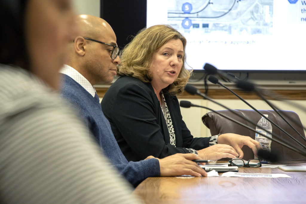 DIA director of infrastructure Michelle Martin addresses a Denver City Council committee on a plan to widen Peña Boulevard between I-70 and Denver International Airport, Jan. 19, 2019. (Kevin J. Beaty/Denverite)