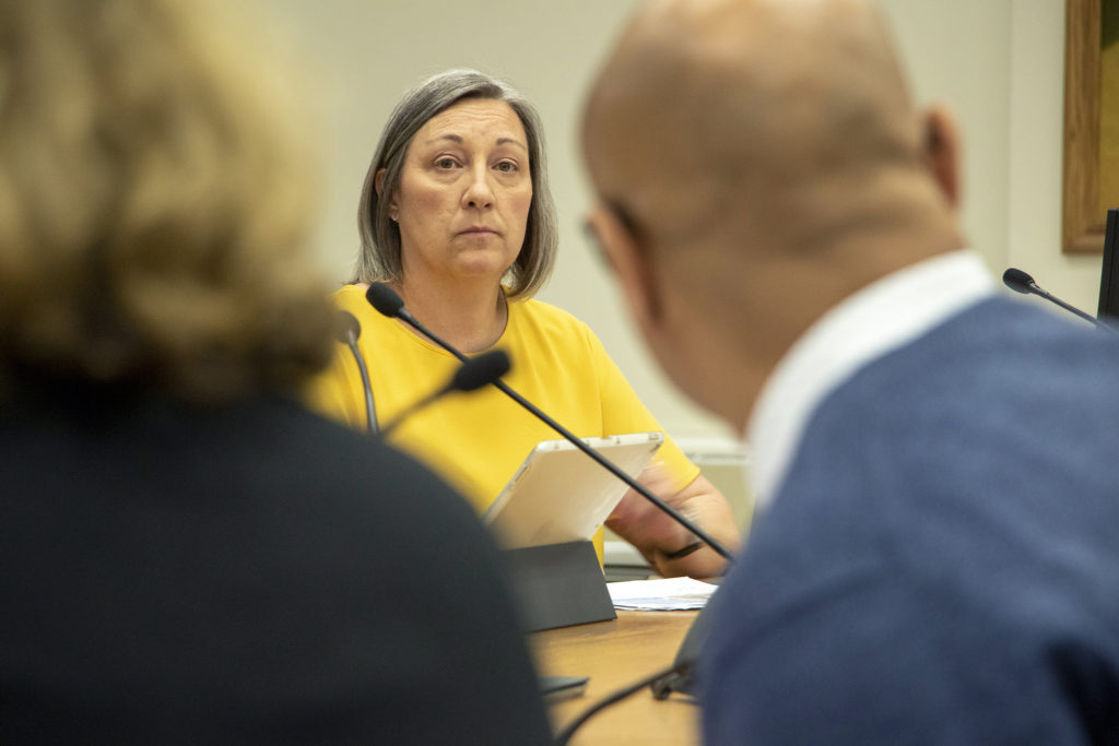 Denver City Councilwoman Stacie Gilmore sits on a committee meeting hearing plans to widen Peña Boulevard between I-70 and Denver International Airport, Jan. 19, 2019. (Kevin J. Beaty/Denverite)