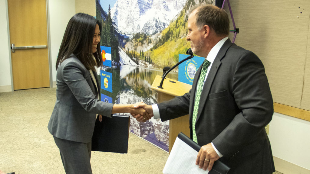 EPA Region 8 Administrator Gregory Sopkin welcomes HUD Regional Administrator Evelyn Lim during an announcement about new rules for lead levels in residential homes. EPA's downtown Denver headquarters, June 21, 2019. (Kevin J. Beaty/Denverite)