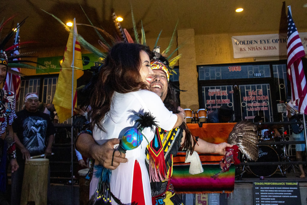 Kieumy Troung and Danny Strange dance during Los Mocochetes' performance at the Little Saigon Night Market. Federal Boulevard, June 21, 2019. (Kevin J. Beaty/Denverite)