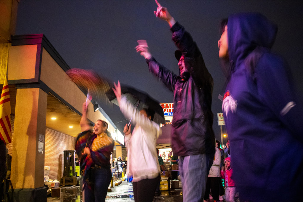 The aucience dances to Los Mocochetes in the rain. Little Saigon Night Market. Federal Boulevard, June 21, 2019. (Kevin J. Beaty/Denverite)