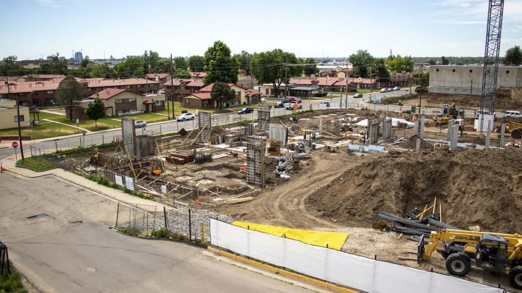 Construction on a DHA housing project at 10th Avenue and Decatur Street in Sun Valley, June 25, 2019. (Kevin J. Beaty/Denverite)