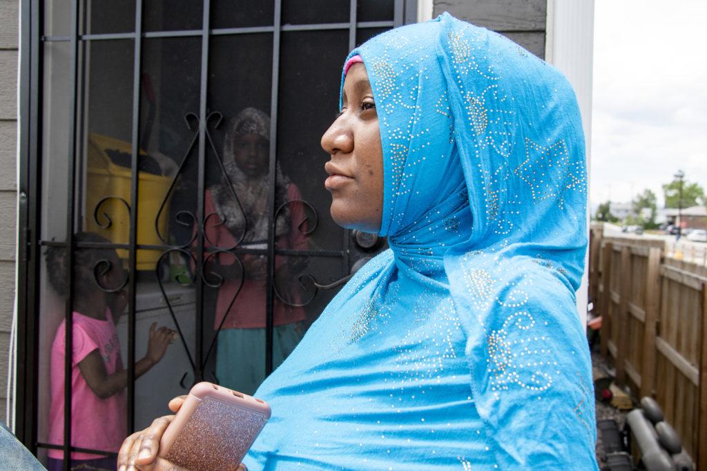 Hawa Haji speaks to a reporter outside her home in Habitat for Humanity's Sheridan Square neighborhood, June 26, 2019. (Kevin J. Beaty/Denverite)