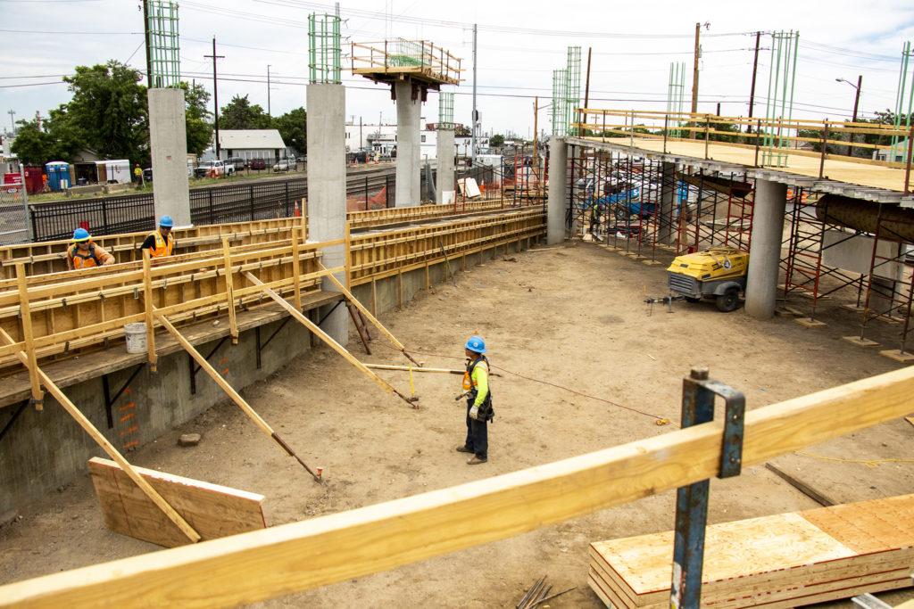 Work on a new pedestrian bridge spanning the York Street railroad crossing in Elyria Swansea, June 27, 2019. (Kevin J. Beaty/Denverite)