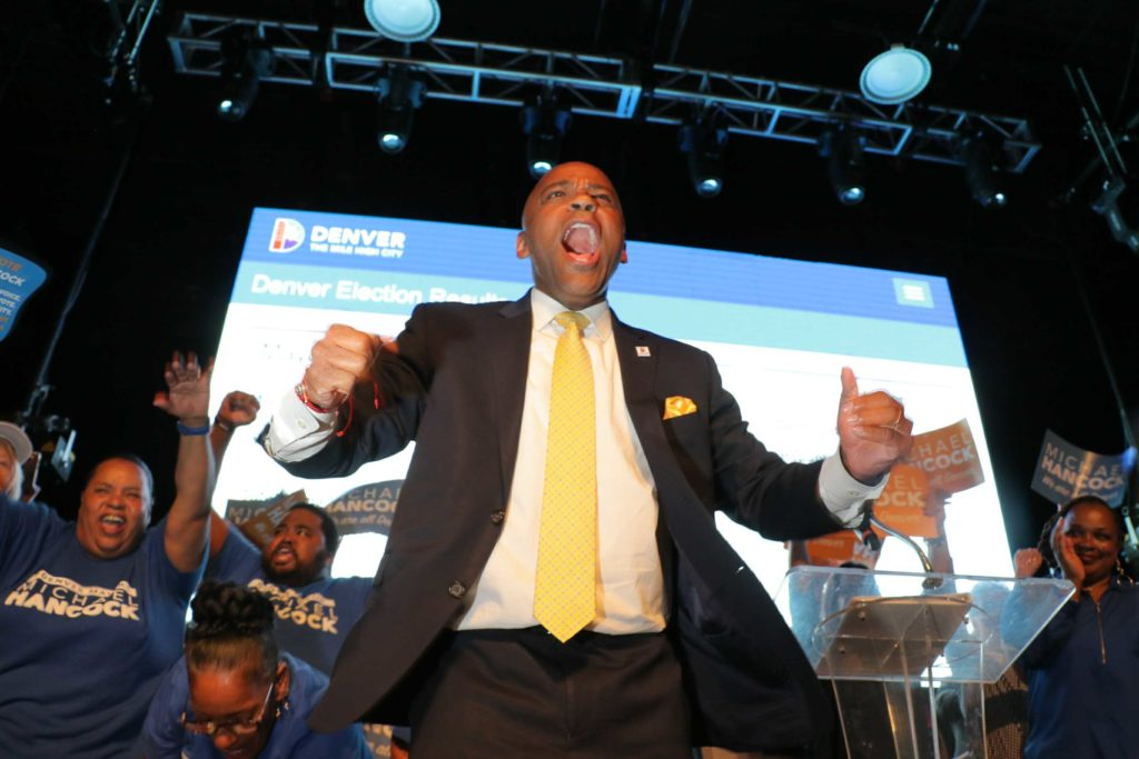 Michael Hancock claims victory in the Denver mayoral race and celebrates at his election night party. (Kevin J. Beaty/Denverite)