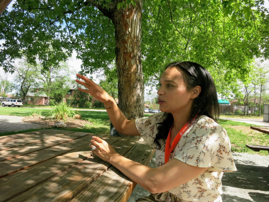 Kristen Wilford-Adams,  the nutrition and wellness specialist at Clayton Early Learning, in the garden on June 14, 2019. (Donna Bryson/Denverite)