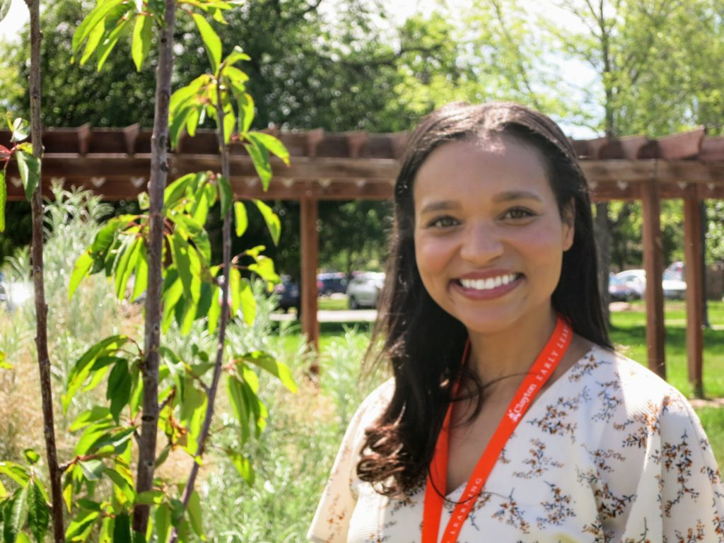 Kristen Wilford-Adams,  the nutrition and wellness specialist at Clayton Early Learning, poses for a portrait in the orchard on June 14, 2019. (Donna Bryson/Denverite)