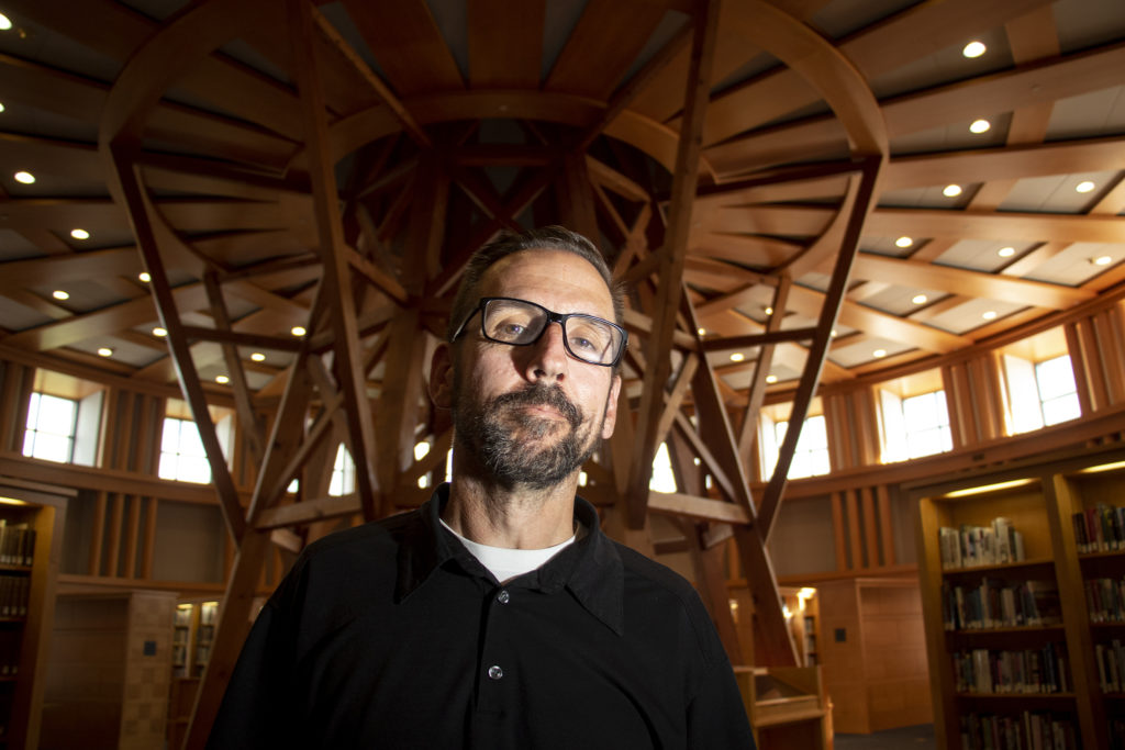Librarian Brian Trembath poses for a portrait inside the Western History Collection on the 5th floor of the central branch on Broadway, July 5, 2019. (Kevin J. Beaty/Denverite)
