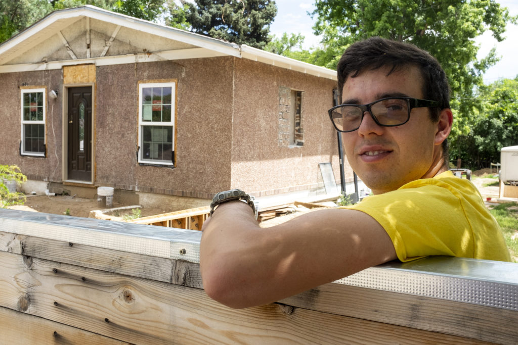 Pavlo Angelchev poses for a portrait during a break from remodeling his home on Quebec Street, July 8, 2019. (Kevin J. Beaty/Denverite)