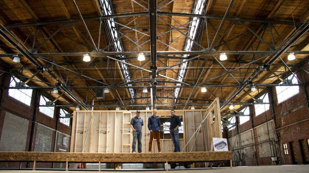 Simple Homes co-founders David Schulttz (left to right) and Jeff Hopfenbeck and architect John Schwarz pose for a portrait in a prefab ADU being built in their Globeville workshop, July 9, 2019. (Kevin J. Beaty/Denverite)