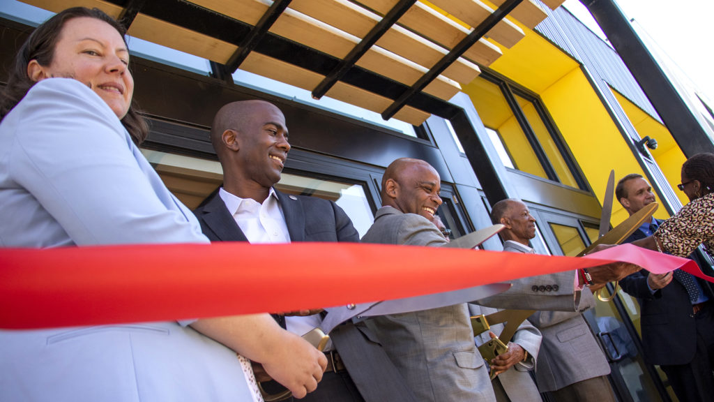 Stakeholders and officials cut the ribbon to officially open the Moline Apartments in Stapleton, July 19, 2019. (Kevin J. Beaty/Denverite)