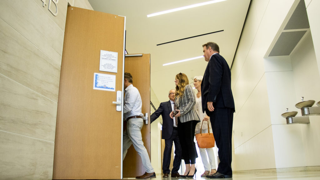 Alexander and Stacy Neir arrive at the Lindsey-Flanigan Courthouse with their attorneys for a hearing, July 11, 2019. (Kevin J. Beaty/Denverite)