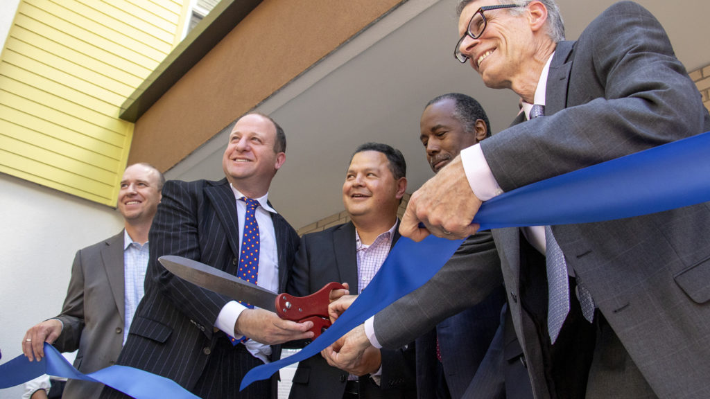 Officials cut the ribbon on a new affordable housing project in Aurora, July 12, 2019. (Kevin J. Beaty/Denverite)