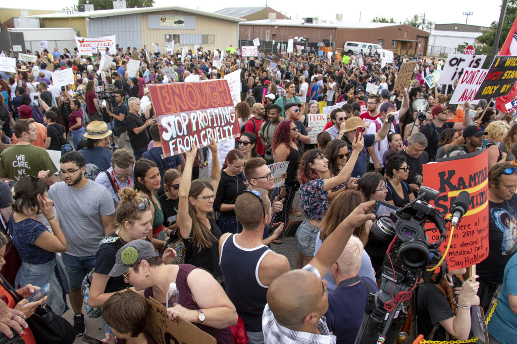 Protesters gather outside of Aurora's private immigration detention facility to denounce ICE raids and jails like this across the country, June 14, 2019. (Kevin J. Beaty/Denverite)
