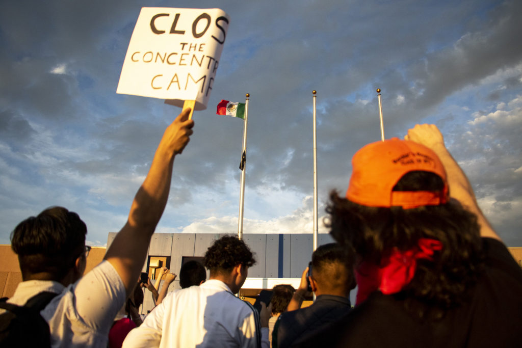 A Mexican flag replaced a Colorado state flag aboce Aurora's private immigration detention facility during a massive protest, June 14, 2019. (Kevin J. Beaty/Denverite)