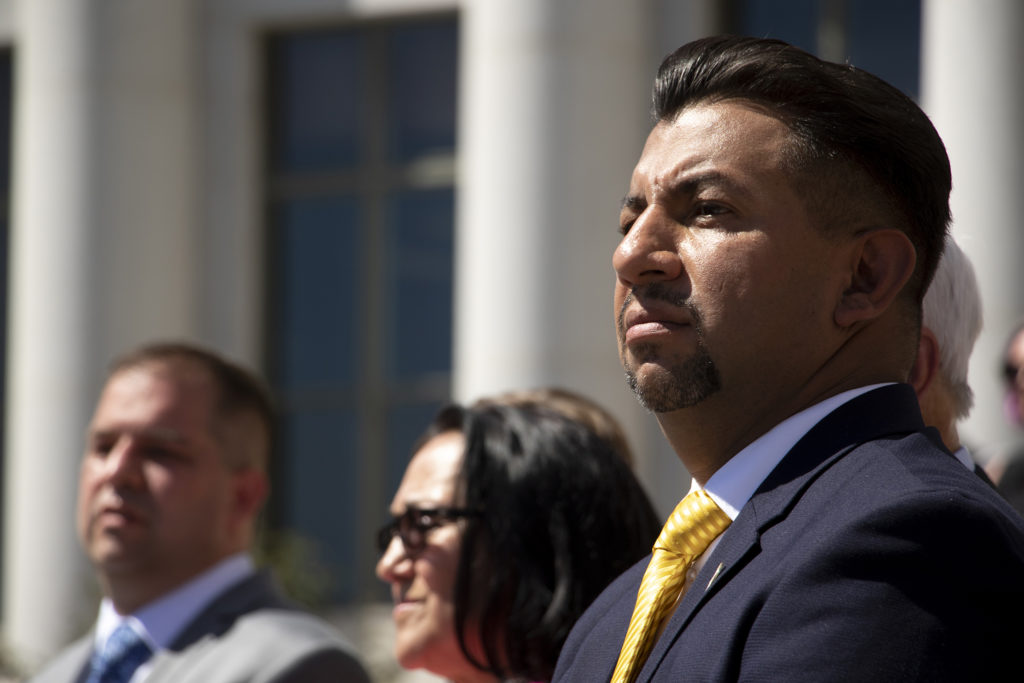 Denver Clerk and Recorder Paul Lopez listen to the Mayor Michael Hancock's speech on Inauguration day on the City and County Building steps, July 15, 2019. (Kevin J. Beaty/Denverite)