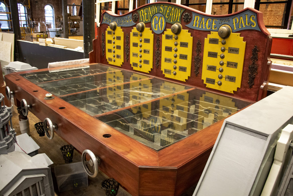 A mechanical labyrinth, in which golfers turn tilt wheels to race to the finish, inside Urban Putt's new location at the old Old Spaghetti Factory building downtown, July 16, 2019. (Kevin J. Beaty/Denverite)
