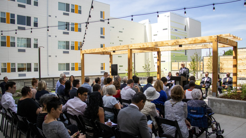 Rocky Mountain Communities interim CEO Tracy Gargaro speaks during a ribbon-cutting ceremony for the Arroyo Village apartments in Denver's West Colfax neighborhood, July 18, 2019. (Kevin J. Beaty/Denverite)