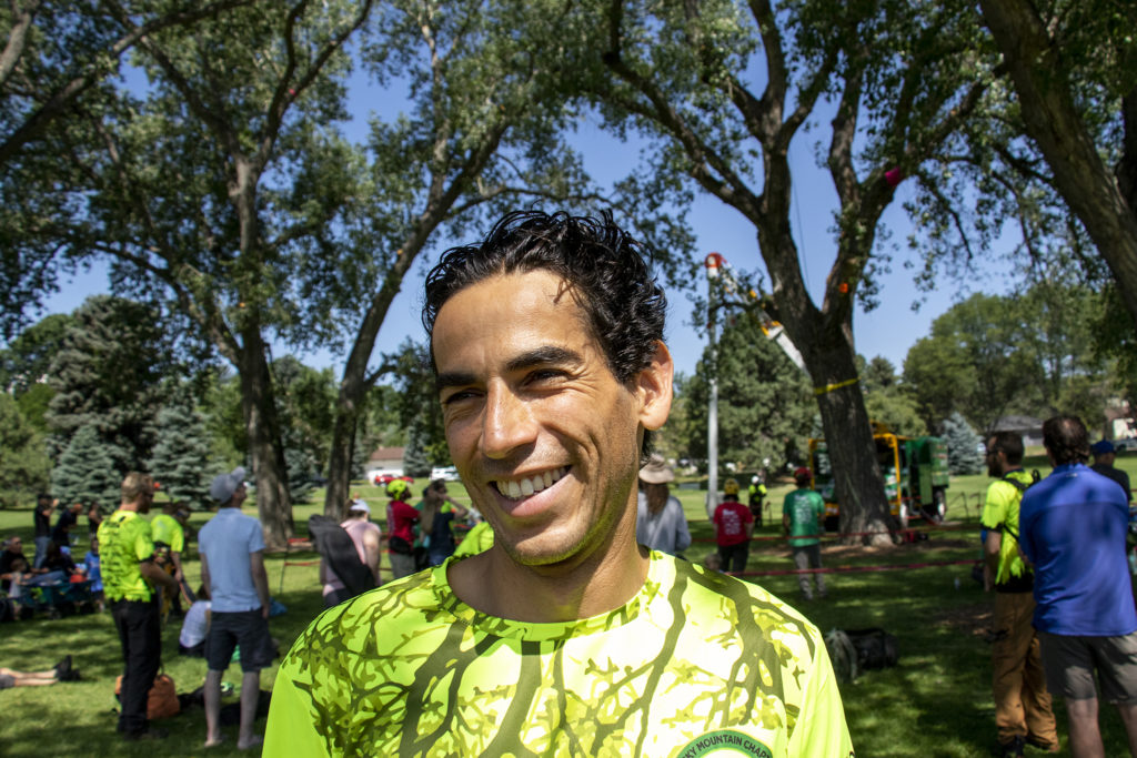 Arborist Axel Avila poses for a portrait. The International Society of Arboriculture's rocky mountain chapter holds their annual regional tree-climbing competition at Crestmoor Park in Hilltop, July 20, 2019. (Kevin J. Beaty/Denverite)
