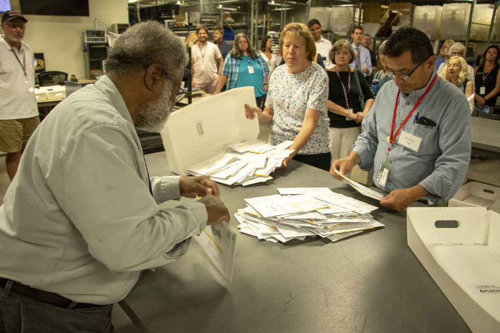 Jefferson County's elections division processes ballots for a special election, July 1, 2019. (Kevin J. Beaty/Denverite)