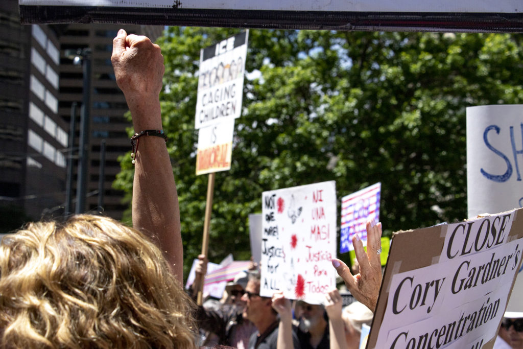 A crowd gathered outside the federal building housing Sen. Cory Gardner's office to protest immigrant detentions in Colorado and along the border. July 2, 2019. (Kevin J. Beaty/Denverite)