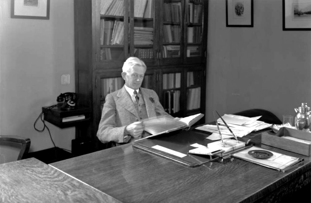 City Librarian Malcolm Glenn Wyer reads a book at his desk in the Denver Public Library in Civic Center Park, Denver, Colorado. 1937. (Denver Public Library/Western History Collection/X-27468)