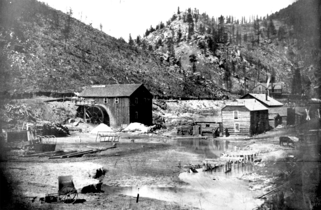 Early view of Clear Creek, the Clear Creek House (sign), and the Eagle Mill operating on North Clear Creek, Colorado, situated between Gregory Gulch and Chase Gulch near Black Hawk. Circa 1860. (Rufus E. Cable/Denver Public Library/Western History Collection/X-2029)