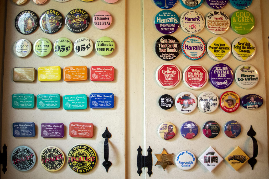 Casino paraphernalia covers the cabinets of Gary Johnson's kitchen, July 25, 2019. (Kevin J. Beaty/Denverite)