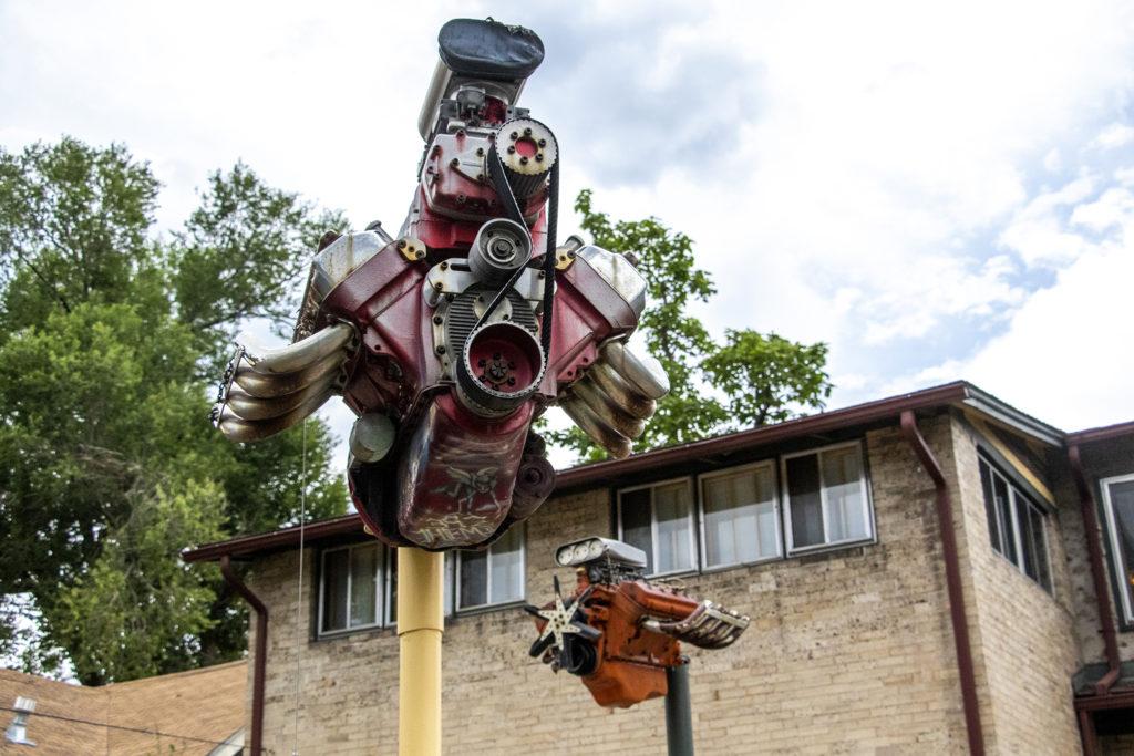 Engines-turned-art in Gary Johnson's backyard west of Washington Park, July 25, 2019. (Kevin J. Beaty/Denverite)