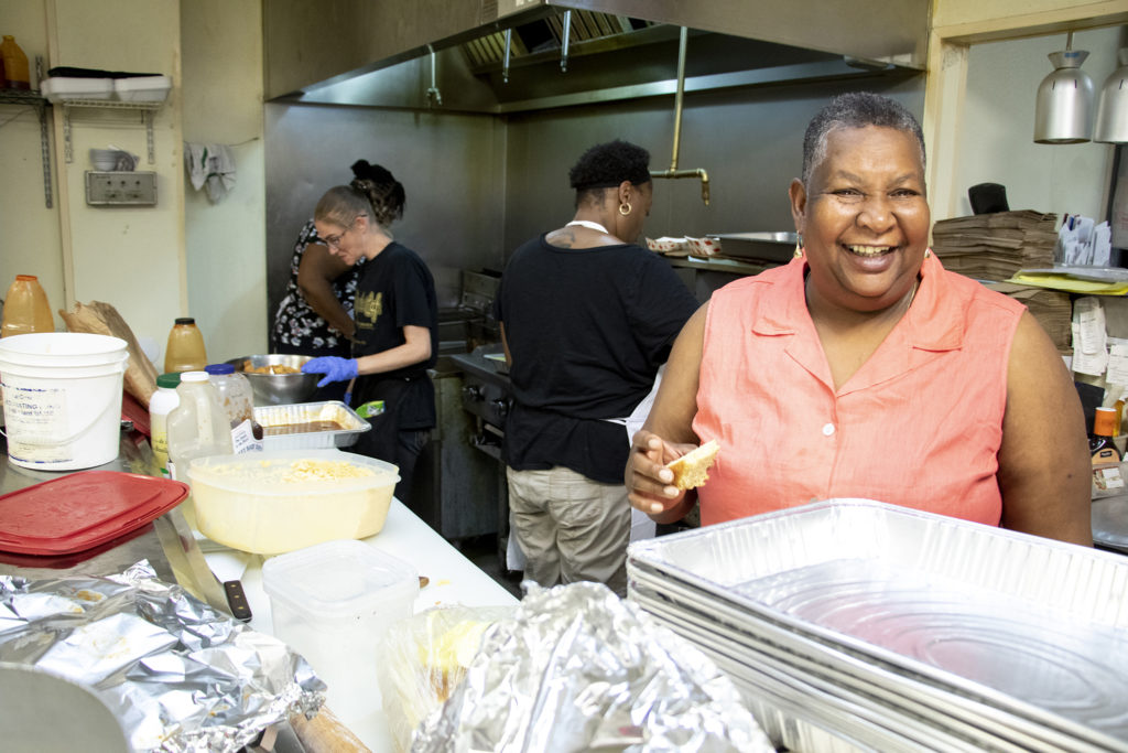 Ms. Mona Dickersons smiles in the Welton Street Cafe's kitchen. Five Points, July 30, 2019. (Kevin J. Beaty/Denverite)