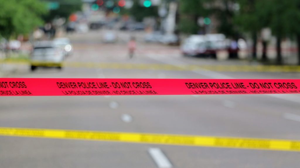 Denver police investigate an officer-involved shooting at 11th Avenue and Lincoln Street. July 1, 2019. (Kevin J. Beaty/Denverite)