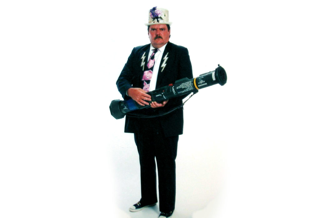 Gary Johnson won a free portrait once. He ignored the offer for months as a salesman called to coax him in. One day, he finally agreed, and smuggled this bazooka into a mall under a blanket to pose with a menacing face, what his son, David, says was his kind of humor. (Courtesy: David Johnson)