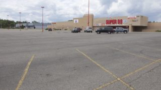 A mostly empty parking lot at the Super 99 Cents store on South Sheridan Boulevard on Monday, July 8, 2019, in Denver. (Esteban L. Hernandez/Denverite)